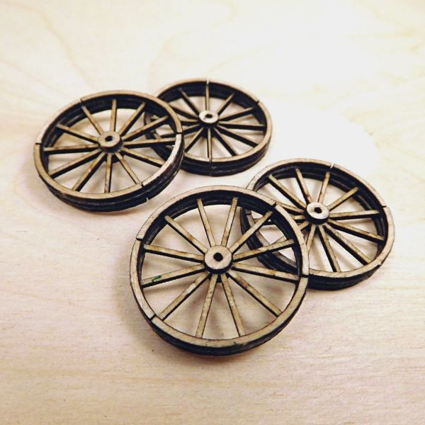<p>This set contains parts to assemble 4 small, 12-spoked, detailed cart wheels (diameter: 26 mm). Includes separate cladding and hub-discs to attach to both sides. <br />