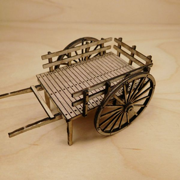 <p>This set contains parts to assemble a detailed handcart. The wheels feature separate cladding and hub-discs on both sides; the cart&#39;s bed features engraved planking and nailheads - and the framework features small holes to enable superdetailing with aftermarket- or scratchbuilt bolts/rivets (not included).<br />