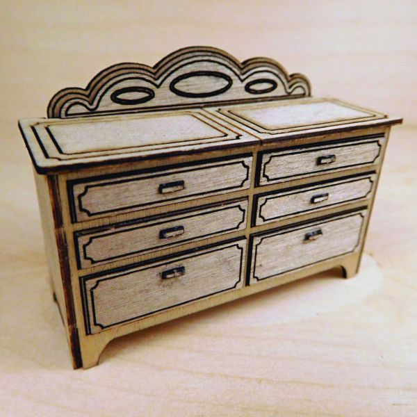 <p>This set contains parts to assemble a detailed dresser.<br />