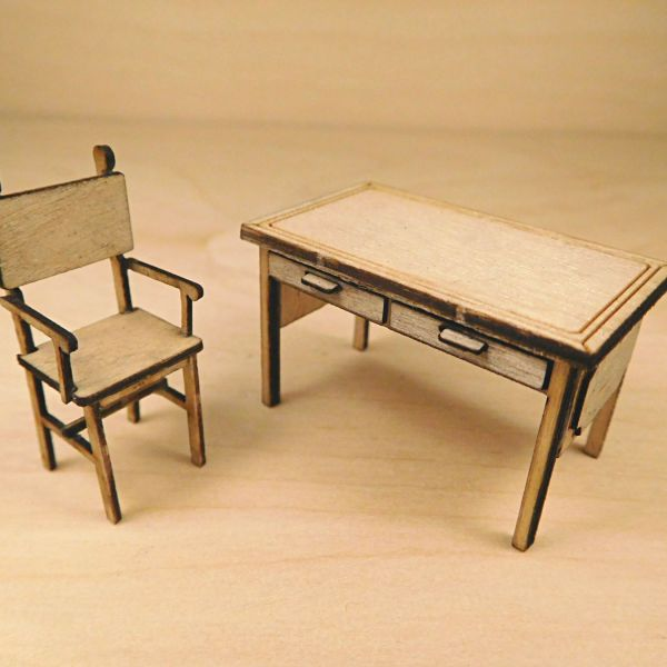 <p>Lasercut plywood (2 different strengths) and wood veneer parts to assemble a detailed desk and chair, with separate drawer fronts and handles, decorative side panels and engraved detail.<br />