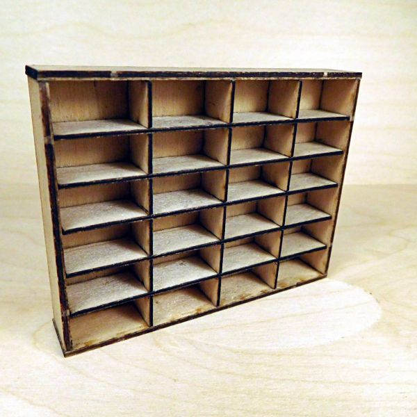 <p>This set contains parts to assemble a large, standing shelving unit with 24 compartments.<br />