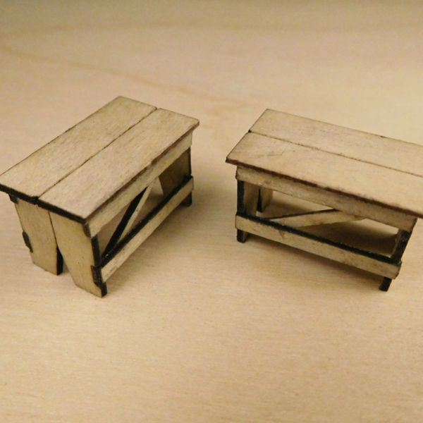 <p>This set contains parts to assemble a pair of detailed wooden workshop-style benches.<br />