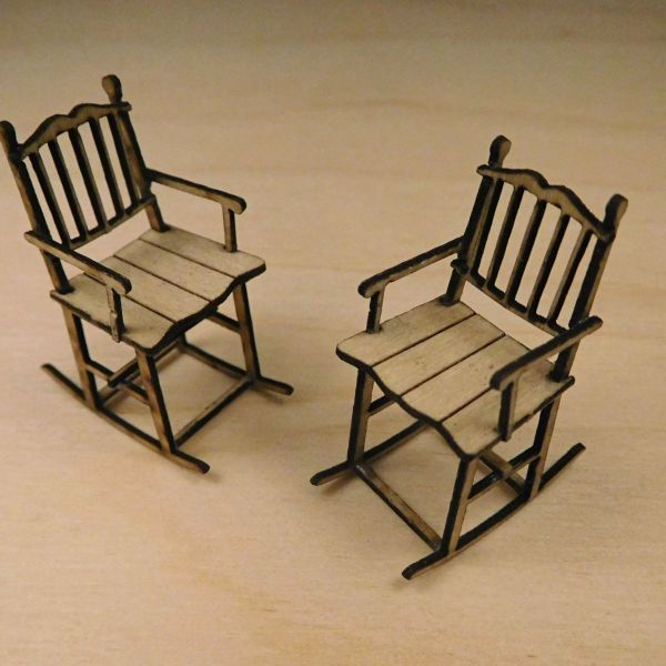 <p>This set contains parts to assemble a pair of detailed wooden rocking chairs.<br />