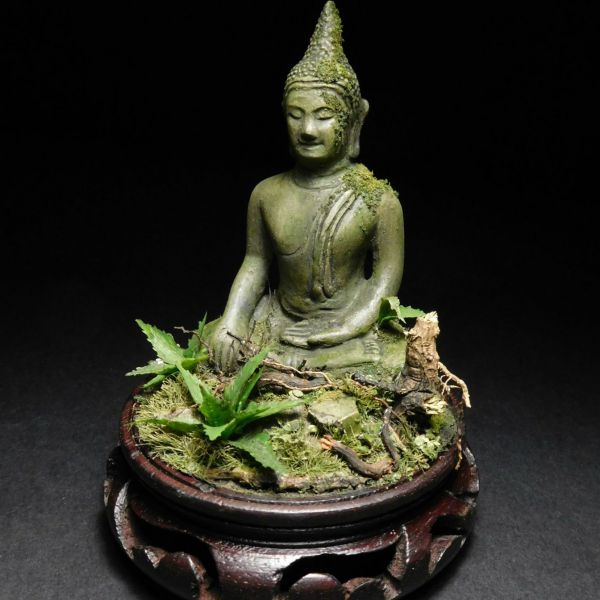 <p>A solid plaster, sitting Buddha-figure.<br />
