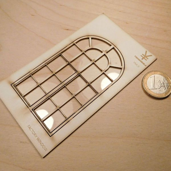 <p>A factory-style window, lasercut from a single plate of silkboard, featuring twin lower parts that can be depicted closed, as supplied - or cut loose and glued in opened positions.<br />
