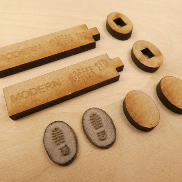<p>This set contains lasercut parts to assemble a pair of 1:35 bootprint-stamps. Each stamp consists of a 3-part MDF handle and a rubber pad featuring a sharply cut bootprint.<br />