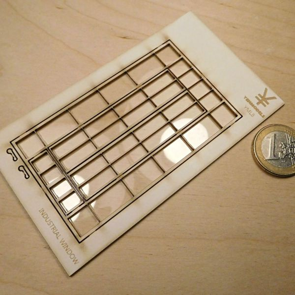 <p>An industrial-style window, lasercut from a single plate of silkboard, featuring central parts that can be depicted closed, as supplied - or cut loose and glued in opened positions.<br />
