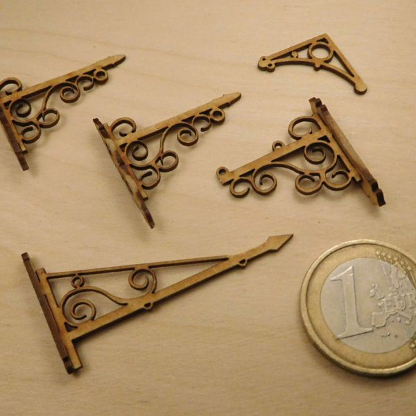 <p>This set contains parts to assemble 5 wrought iron sign-brackets: one identical pair and three varying ones.<br />