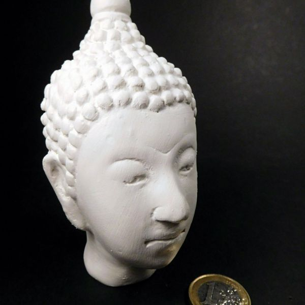 <p>DISCONTINUED: 50% OFF.<br /> <br /> A large, solid plasterBuddha-head.<br /> Weight: 166 gs.<br /> Dimensions: 114 x 60 x 69 mm.</p>