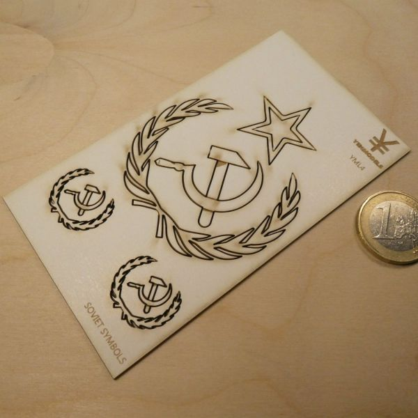 <p>One large (58 mm diameter) and two small (21 mm diameter) Soviet hammer-and-sickle-emblems surrounded by laurel wreaths, laser-cut and -engraved in 1,5 mm strong silkboard.<br />
