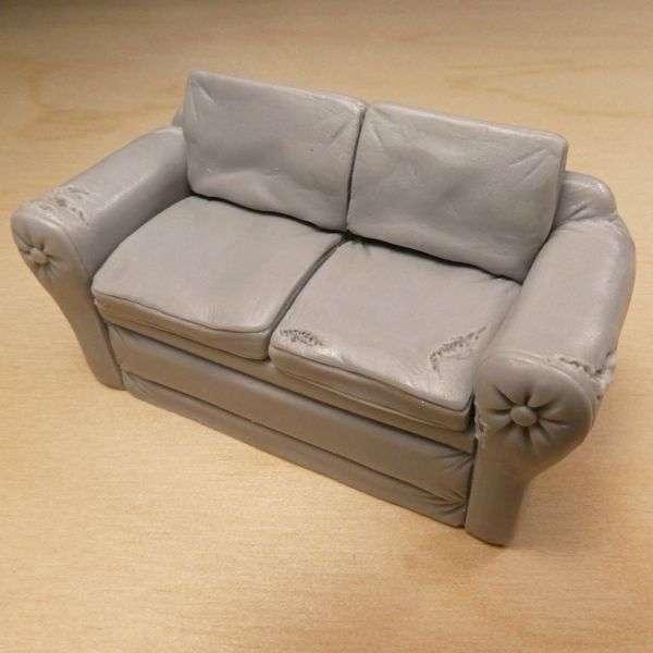 <p>A worn old sofa: consisting of 5 solid, cast resin parts (sofa and 4 cushions).</p>