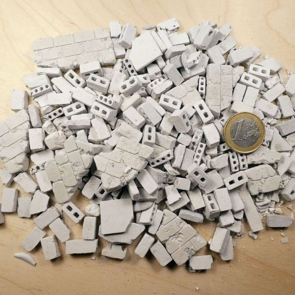 "<p>Cast plaster ""concrete"" block rubble, including (pieces of) walls, tiles, and both solid blocks and (two types of) hollow blocks.<br />