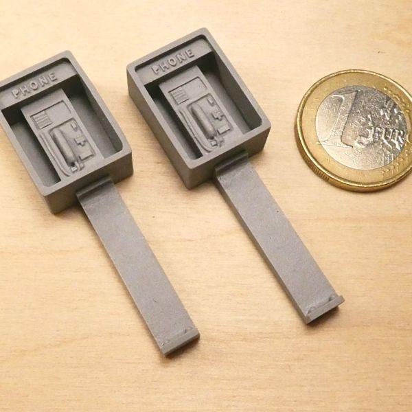 <p>2 identical public payphones.</p>